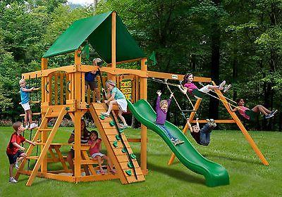 outdoor chateau swing set with deluxe green